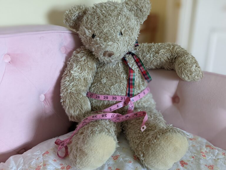 bear with soft measuring tape for body fat